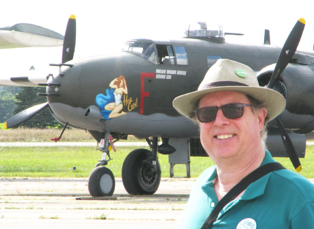 Bob poses with the Canadian warplane Heritage Lancaster Bomber, sporting a pinup girl as nose art