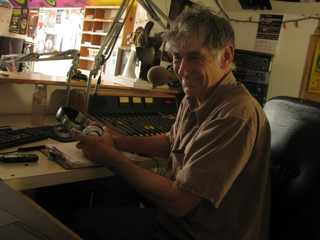 Jeff Stager in the control booth of SoundFM