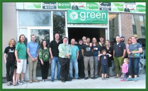 People standing in front of the WRGreens Campaign Office